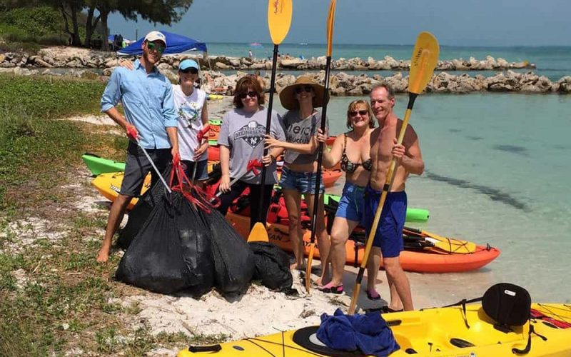 Group of volunteers gathered for cleanup of Happy Paddler's adopted Keep Manatee Beautiful beach